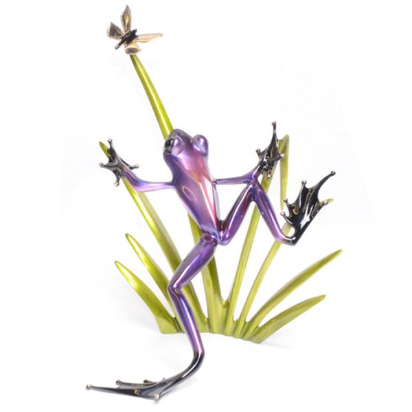 Odyssey is a bronze frog sculpture by Tim Cotterill. This piece features a silver nitrate purple frog leaping from the grass to capture a butterfly.