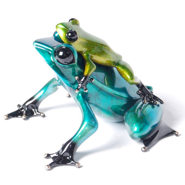 Joy Ride is a whimsical, jewel toned, limited edition bronze frog. It features a brilliant blue momma frog, carrying her young across her back. The baby frog is finished in a metallic green patina. This sculpture was created by Tim Cotterill the Frogman.