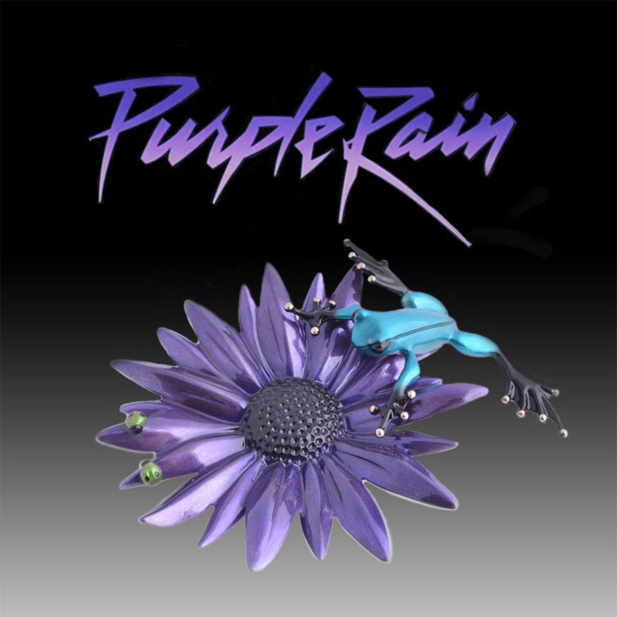 Purple Rain is a limited edition bronze frog created to honor the legendary Prince. It features a bright purple sunflower with a dark black center. A curious blue frog is inspecting the flower and has found two bright green lady bugs