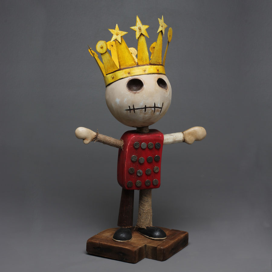 This sculpture is from a twenty five piece collection created by father, daughter duo, Trent and Harlow Manning. 9 year old Harlow provided the concept drawls and Trent recreated the collection as sculptures and two d paintings. The Star King is a male figure created from scrap wood, metal, clay and then hand painted with a golden crown with stars. Harlow finishes off each piece with hand embellishments.
