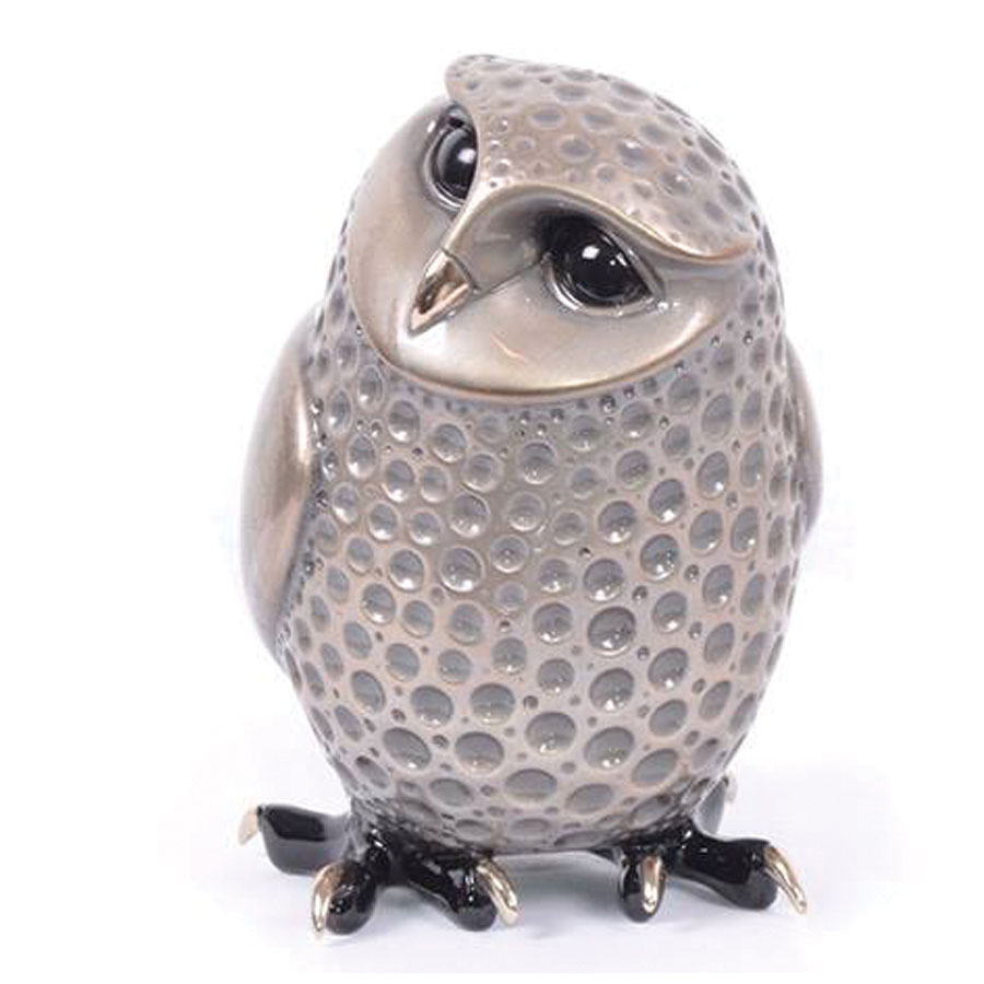 Alfie by Tim Cotterill is a rare limited edition bronze owl with a metallic silver nitrate patina. HIs eyes and feet are dark black, his beak and talons are polished raw bronze, that looks golden in color. This pieces is a part of the artists birds of prey series and is limited to an edition of five hundred sculptures.
